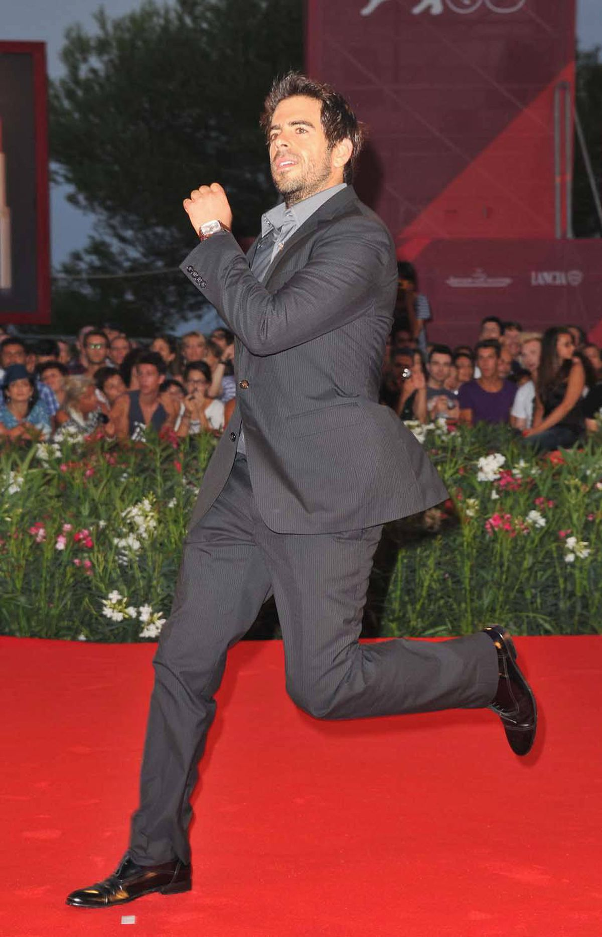 """Eli Roth attended the """"Carnage"""" premiere as a gentleman dashing."""