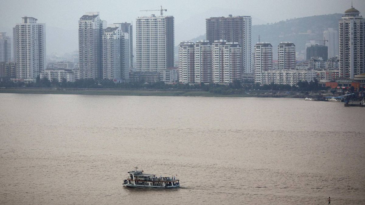 A ferry crosses a river in Wenzhou. Ranked fourth-richest city in China, its impressive but spookily empty real estate projects make it feel larger than its population of three million.