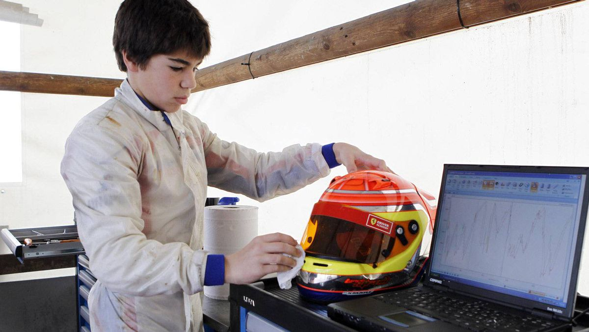 Kart driver Lance Stroll of Canada checks diagnostics ahead of a training session at the South Garda Karting circuit in Lonato, northern Italy December 15, 2011. Photo: Alessandro Garofalo