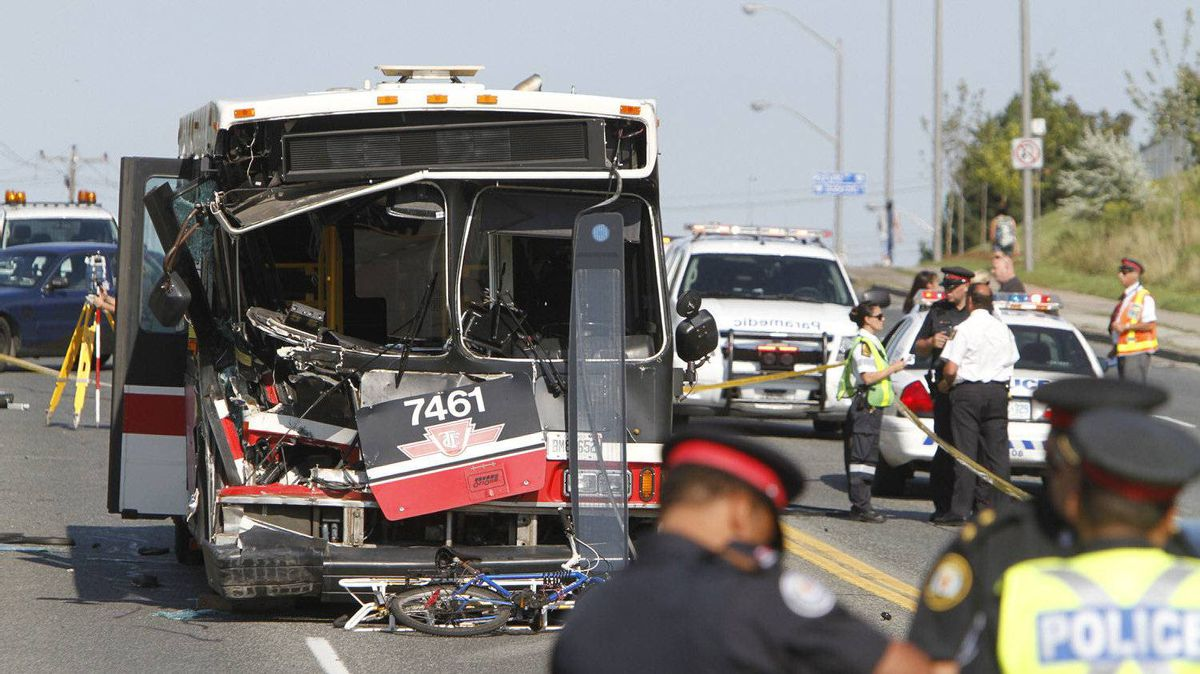 Toronto Police at the scene of a collision involving a TTC bus on Lawrence Avenue at Don Valley Parkway, Toronto August 30, 2011.