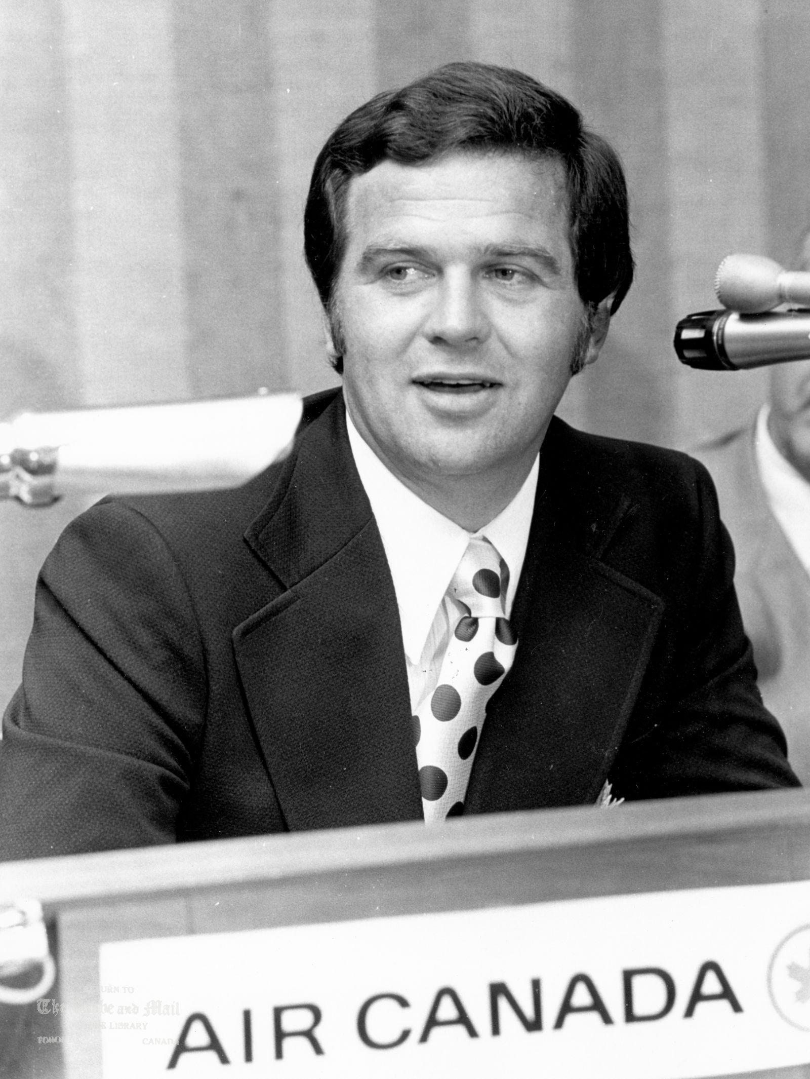 JULY 17, 1972 -- TEAM CANADA TV ARRANGEMENTS -- Team Canada officials gather in Toronto on July 17, 1972 to make announcement concerning television arrangements for upcoming Canada-Russia Summit Series. Team Canada's head coach Harry Sinden speaks into the microphone. Sinden and his group are due to leave this evening for Russia to complete arrangement for the games at Moscow. The series is set to start in Montreal on Sept. 2, 1972. Photo by Tibor Kolley / The Globe and Mail.