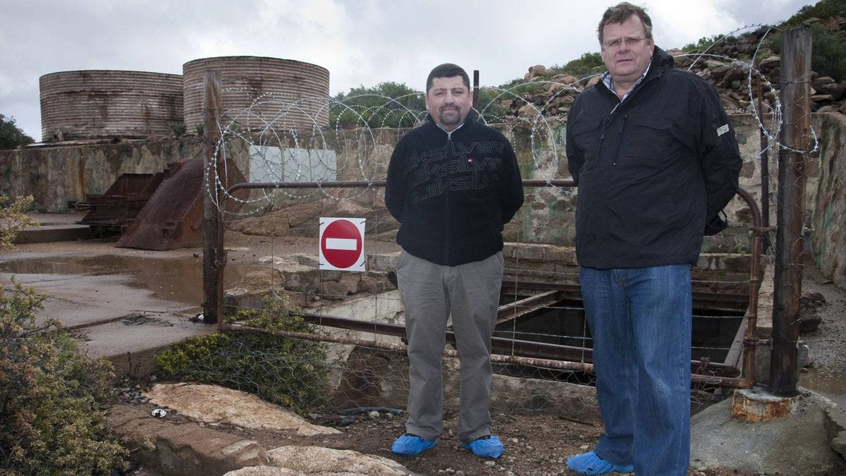 Vincent Mora (L), project director at Steenkampskraal mine in South Africa, is working around the clock to try and get the mine up and running as soon as possible. The mine was abandoned in 1963 and is now being turned into a rare earths mine. He is working closely with Robbie Louw (R), former managing director of Rareco and now a consultant to Great Western. They are standing in front of the old mine shaft.