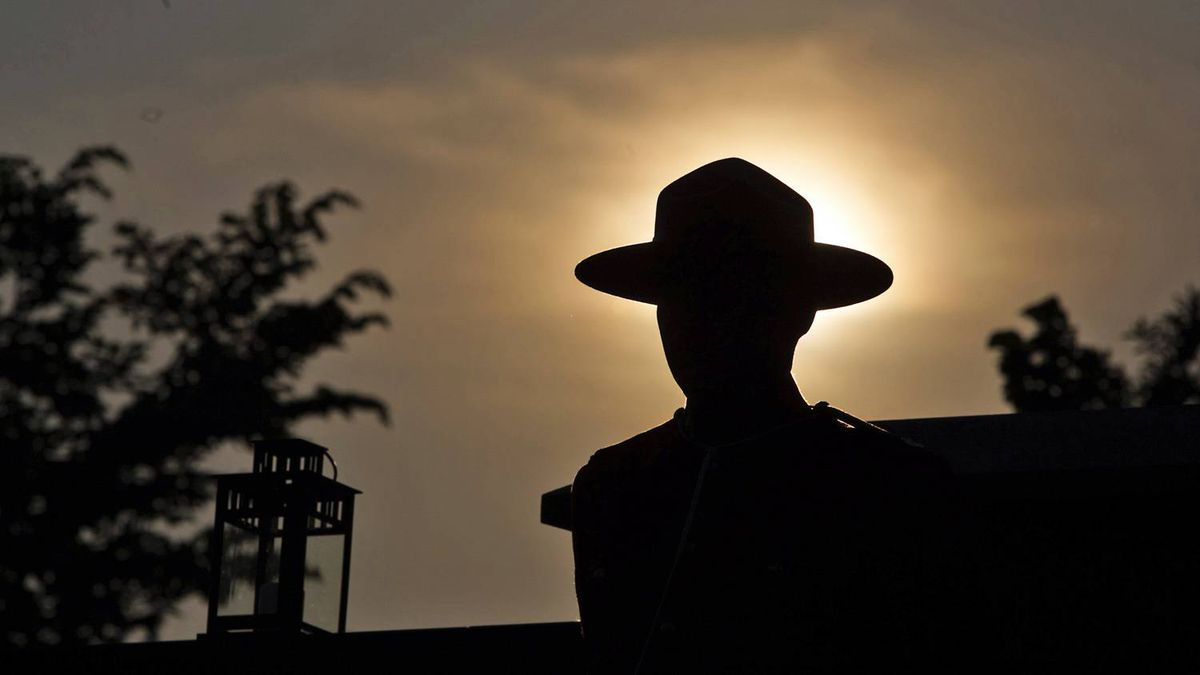 The silhouette of an RCMP officer wearing traditional Mountie serge.