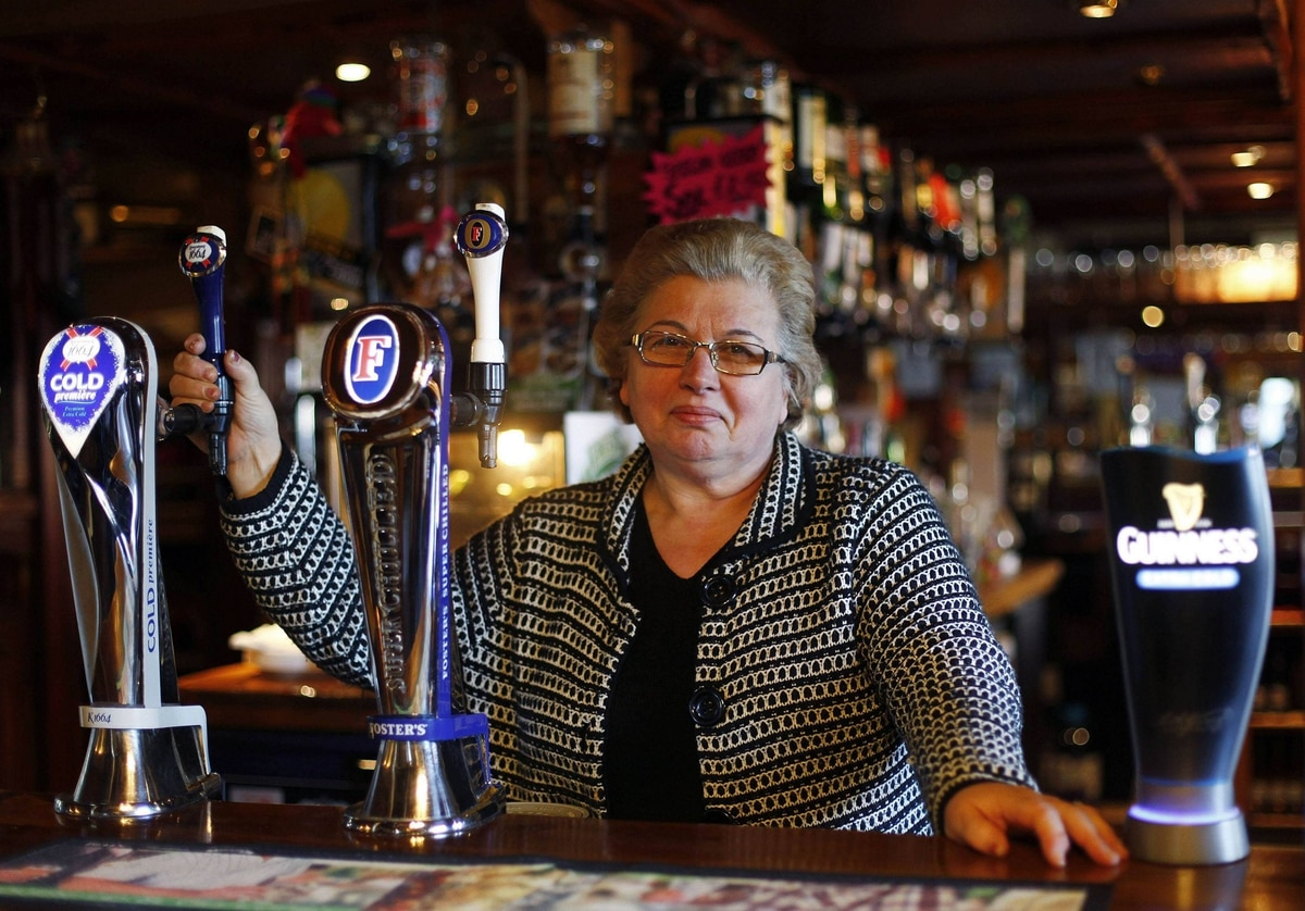 The landlady at the Greyhound pub Isabel Castro Carollo poses for a photograph in east London. The pub was rebuilt after being bombed during World War II. The pub is one of many traditional east end pubs that are situated within a mile of the Olympic Park where the 2012 Olympic Games will take place this summer.