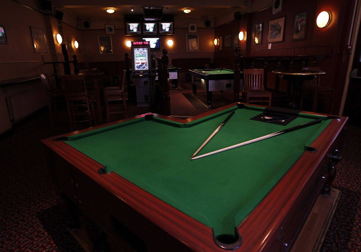 An L-shaped pool table is seen inside the Adam and Eve pub in east London.