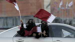 Qatari women wave the national flag as they celebrate in Doha December 3, 2010. FIFA gave its ultimate recognition to emerging markets on Thursday by awarding the 2018 and 2022 editions of the prestigious and lucrative World Cup soccer finals to Russia and Qatar, both new hosts.