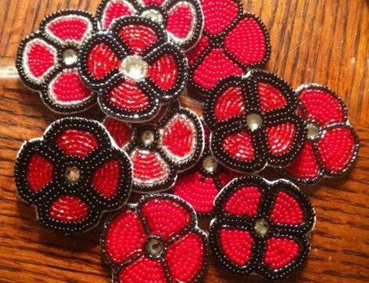 hand made poppies proudly worn by aboriginal veterans to show
