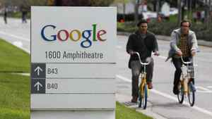 Google workers ride bikes outside of company headquarters in Mountain View, Calif., April 12, 2012.