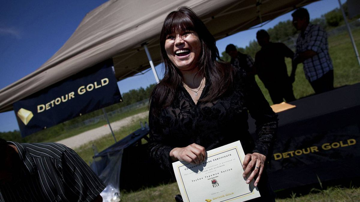 Taykwa Tagamou Chief Linda Job receives a ceremonial share certificate from Detour Gold Corp. as part of a joint venture that will see co-operation between the native community and the mining company.