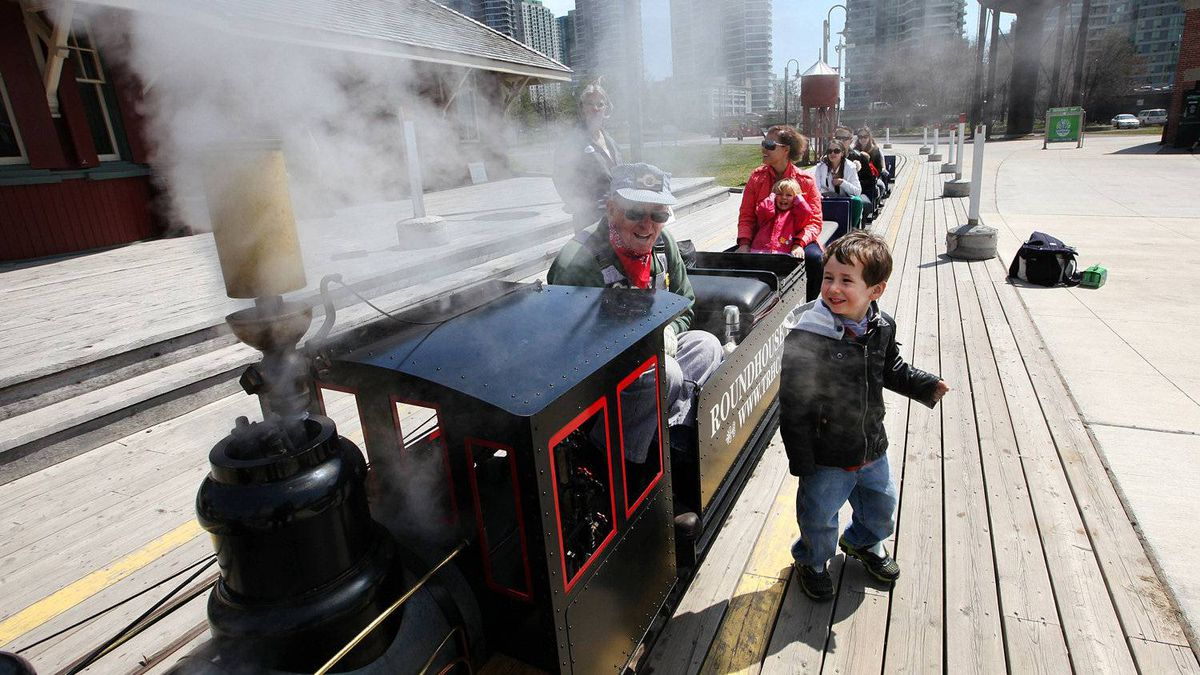 Amir Azizov, 4, reacts as steam is blown from the whistle of the Toronto Railway Historical Association's live steam miniature railway in the Roundhouse Park in Toronto on April 20, 2012, volunteer Mike Salisbury. The TRHA rebuilds trains engines and cars in three bays of the roundhouse on John Street, and has outdoor exhibits but was planning to build the centrepiece, a museum with interactive trains, archives and other items donated to the association in what is called the machine shop, which is now being taken over by Toronto Hydro, who are planning to build a transformer in the building, leaving the museum with no home.