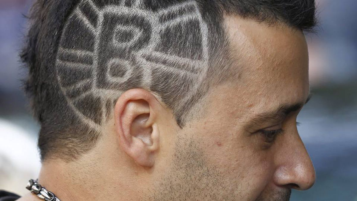 Eddie Medeiros, of Toronto, walks around the TD Garden with a Boston Bruins logo shaved into his head before Game 6.