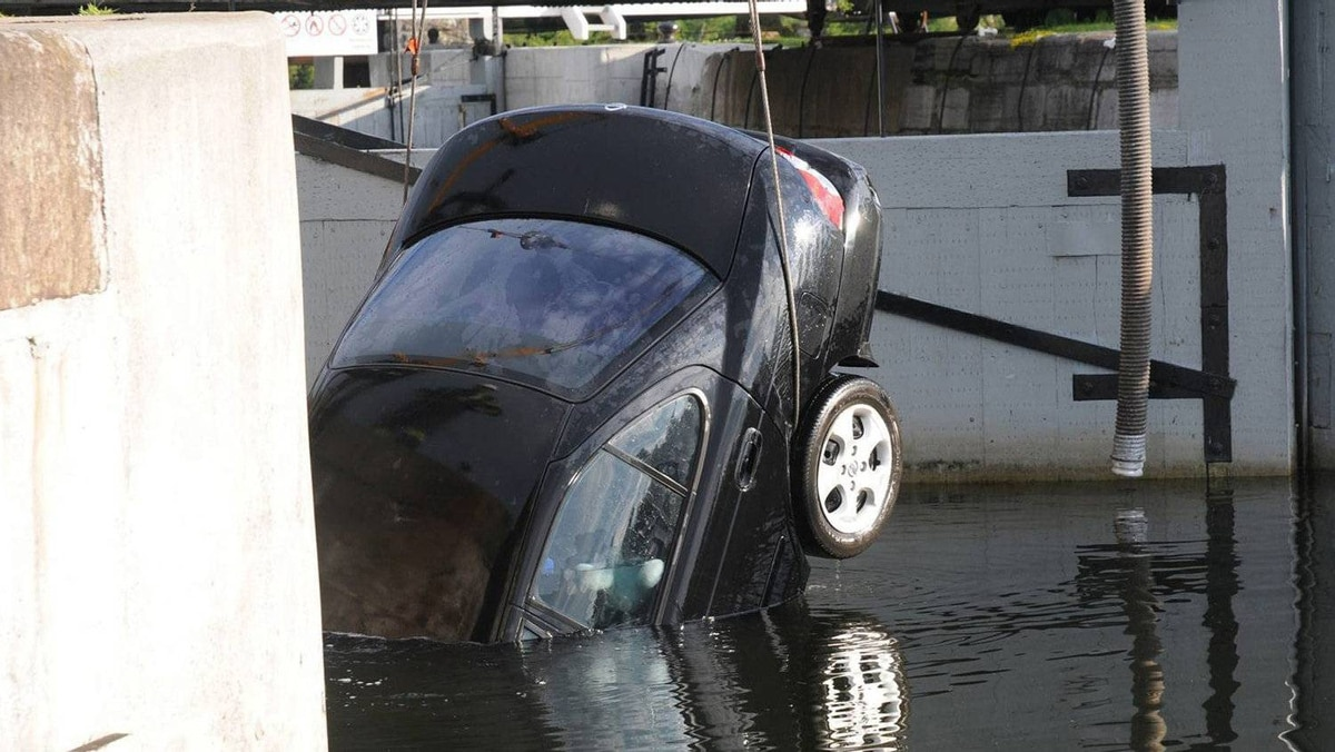 The car in which the bodies of four members of the Shafia family were found is removed from the Kingston Mills locks in 2009.