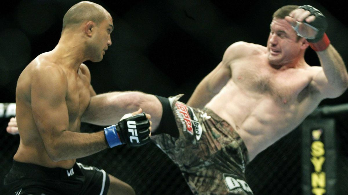 B.J. Penn, left, takes a kick from Matt Hughes during the first round of a Ultimate Fighting Championship welterweight mixed martial arts match Saturday, Nov. 20, 2010, in Auburn Hills, Mich. Penn defeated Hughes in 21 seconds of the first round. (AP Photo/Duane Burleson)