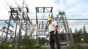 A Fortis power line, with CEO Stan Marshall