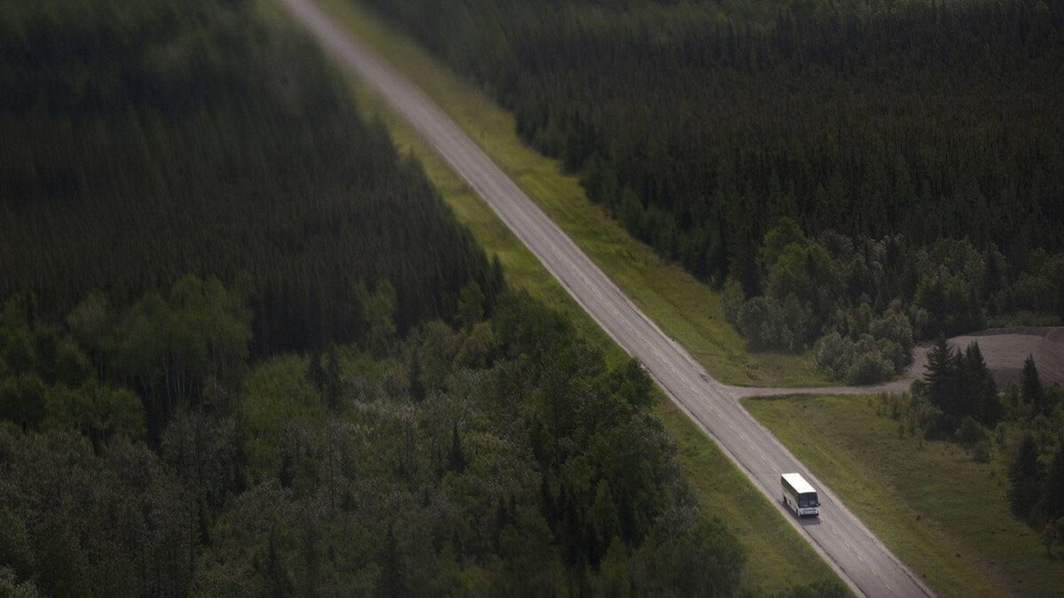 Buses transport workers along Highway 652, the only access road to the Detour Lake mine project, about 180 kilometres northeast of Cochrane, Ont. The trip takes about three hours.