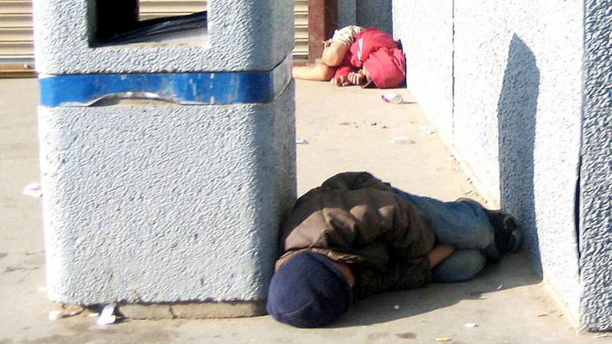 The capital of Nunavut, Iqaluit, is outraged over this picture of two young boys sleeping on the street outside a local grocery store on July 26, 2009.