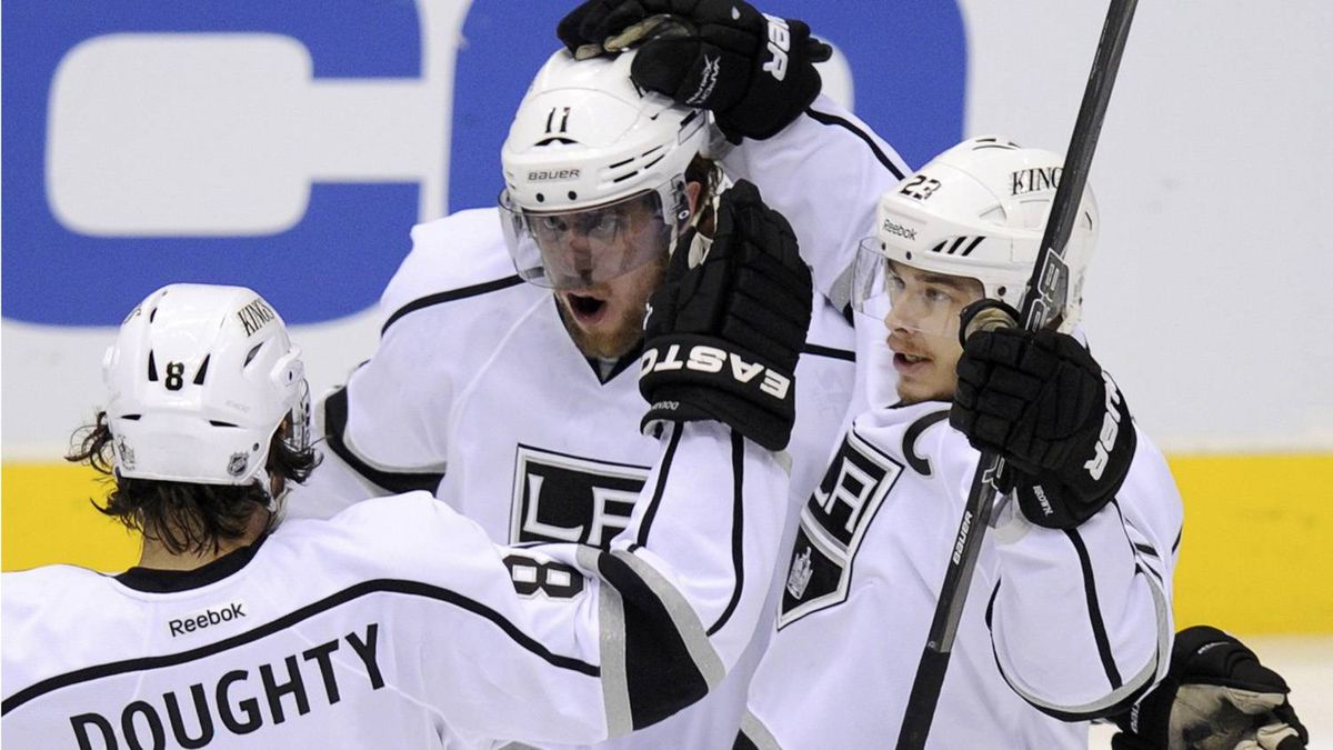 Los Angeles Kings center Anze Kopitar (C) celebrates his 1st period goal against the Phoenix Coyotes with teammates Drew Doughty (8) and Dustin Brown (23) during Game 5 of the NHL Western Conference hockey finals in Glendale, Arizona, May 22, 2012. REUTERS/Todd Korol