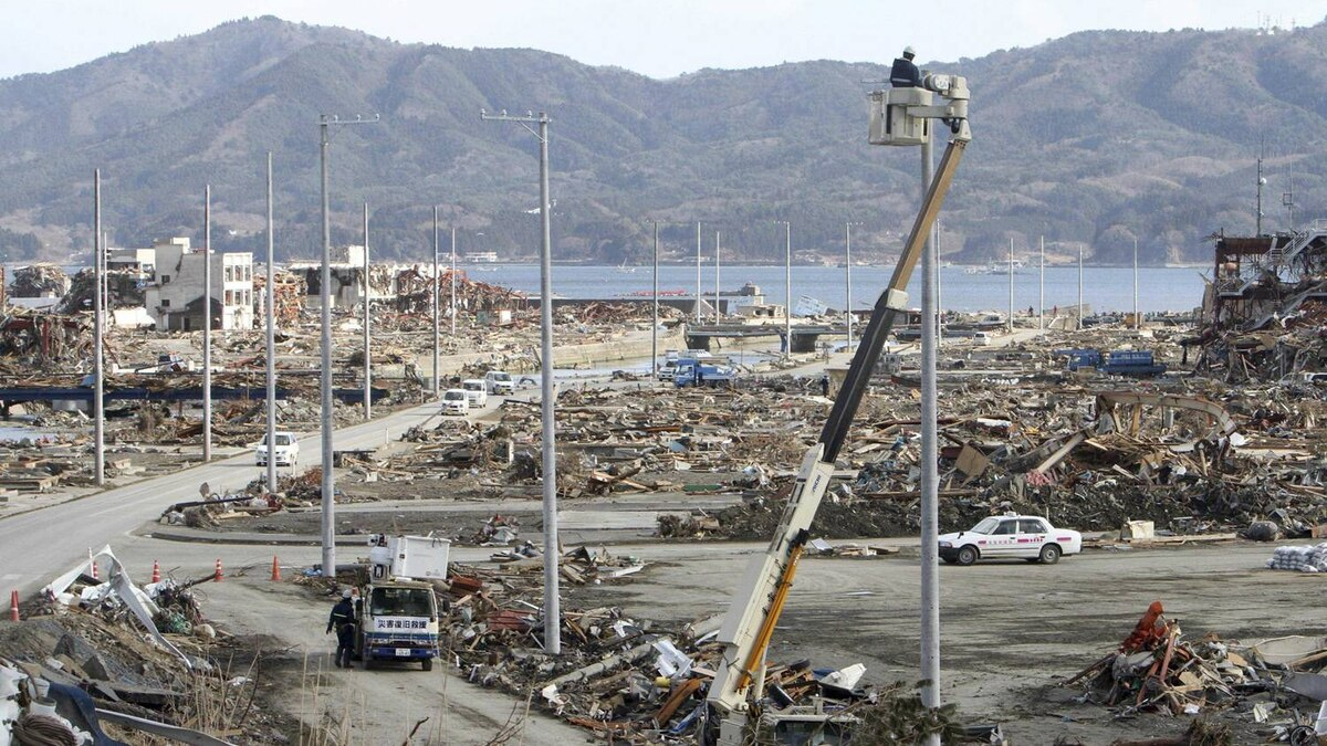 Electricity polls are being erected along a street in the tsunami-ravaged town of Minamisanriku in Miyagi Prefecture Sunday, March 27, 2011, following the March 11 earthquake and tsunami slammed northeastern Japan.