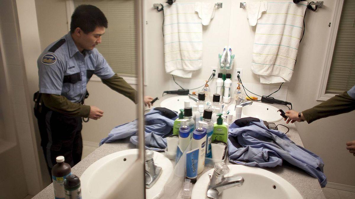Cpl. Regan Yee, 27,at his Calgary home before his night shift.
