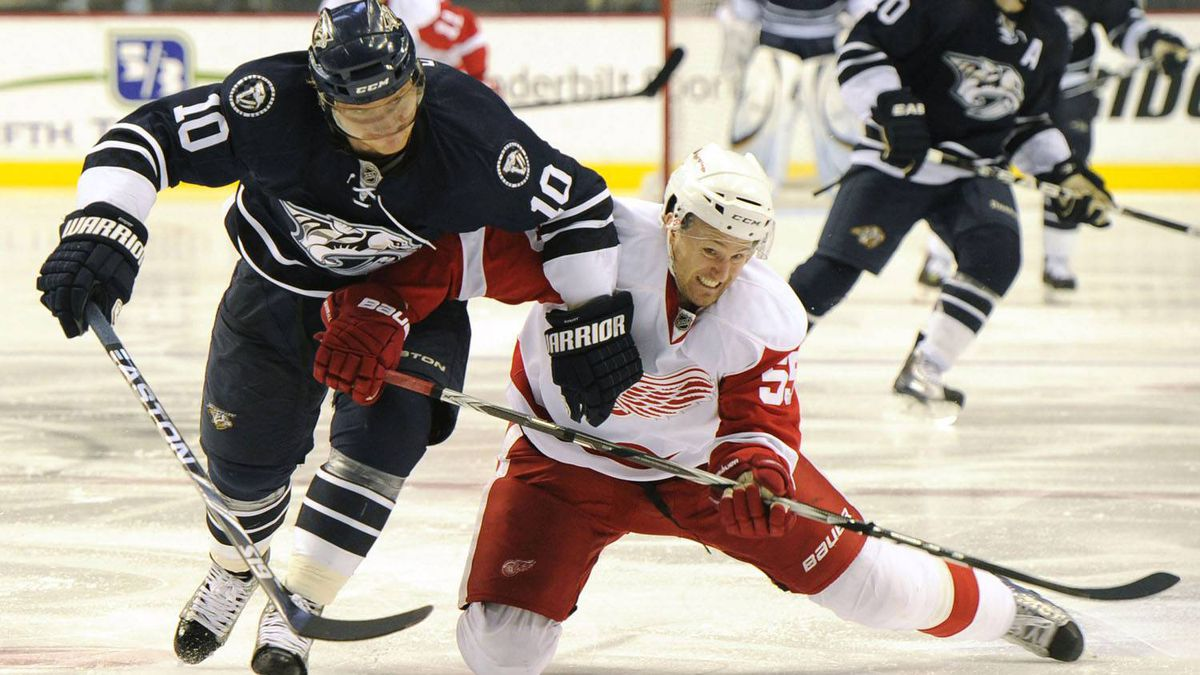Nashville Predators left wing Martin Erat (10), of the Czech Republic, and Detroit Red Wings defenseman Niklas Kronwall (55), of Sweden, fight for the puck during the third period of an NHL hockey game in Nashville, Tenn., Saturday, Feb. 5, 2011. The Predators defeated the Red Wings 3-0. (AP Photo/Frederick Breedon)