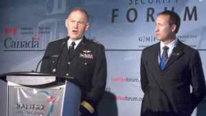 Defence Minister Peter MacKay, right, looks on as General Walter Natynczyk, chief of the defence staff, answers a question at the Halifax International Security Forum in Halifax on Sunday Nov. 22, 2009.