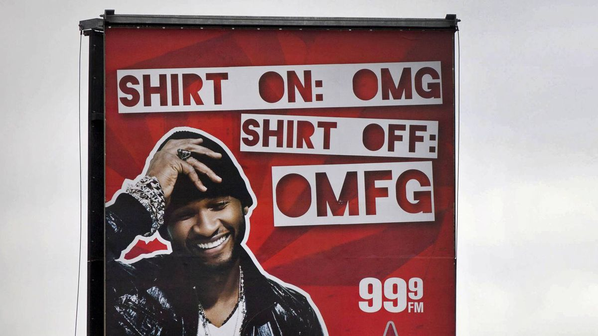 A billboard for Virgin radio featuring hip-hop artist Usher appears on Bloor Street West at Dundas on March 22, 2011.