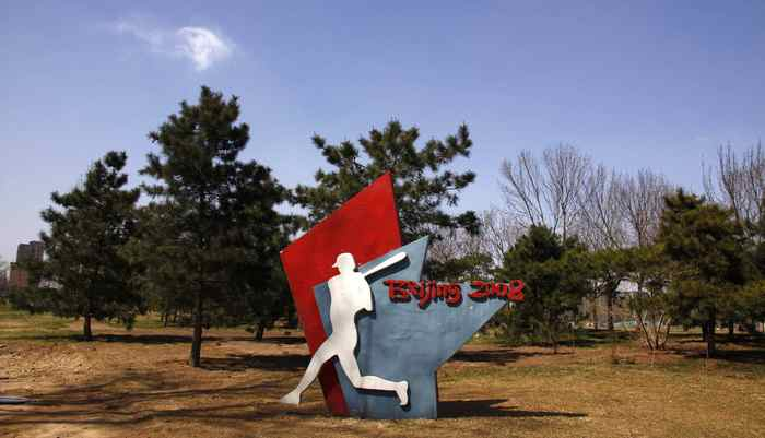 A sign stands at a deserted field showing where the stadium for the 2008 Olympic Games baseball competition once stood in central Beijing March 30, 2012.