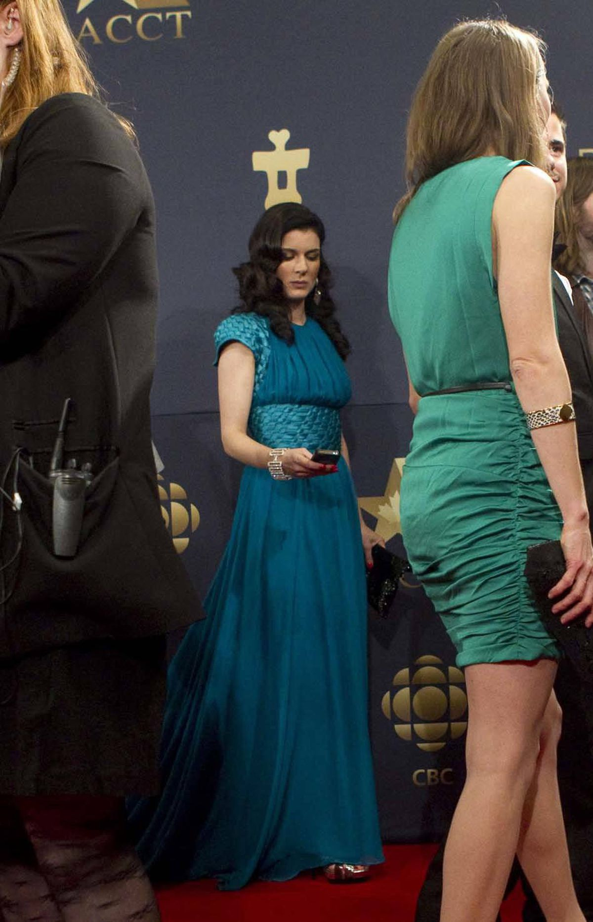 """Gabrielle Miller of the cancelled Canadian sitcom """"Corner Gas"""" checks to see if she got that coveted role in the next Rogers wireless commercial at the Genie Awards in Toronto last week."""