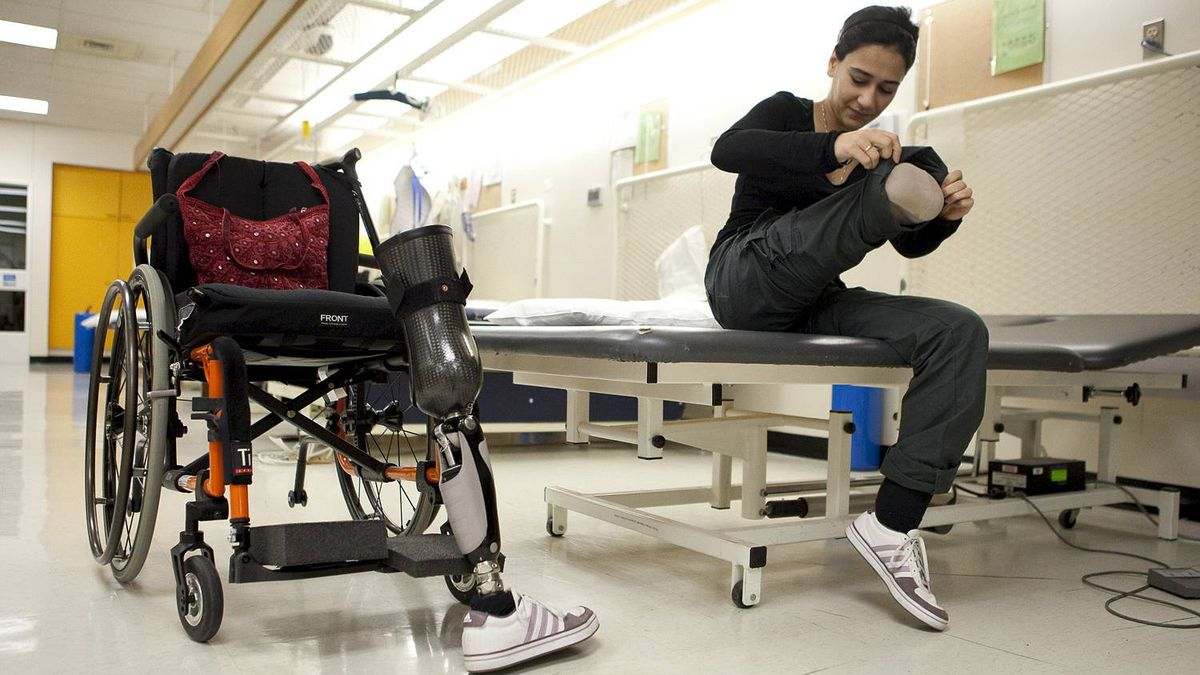 Bushra Saeed works through her daily physiotherapy routine at the Rehabilitation Centre in Ottawa.