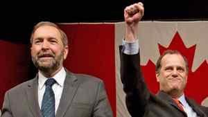 Candidates Thomas Mulcair and Brian Topp greet supporters before the final NDP leadership debate in Vancouver on March 11, 2012.
