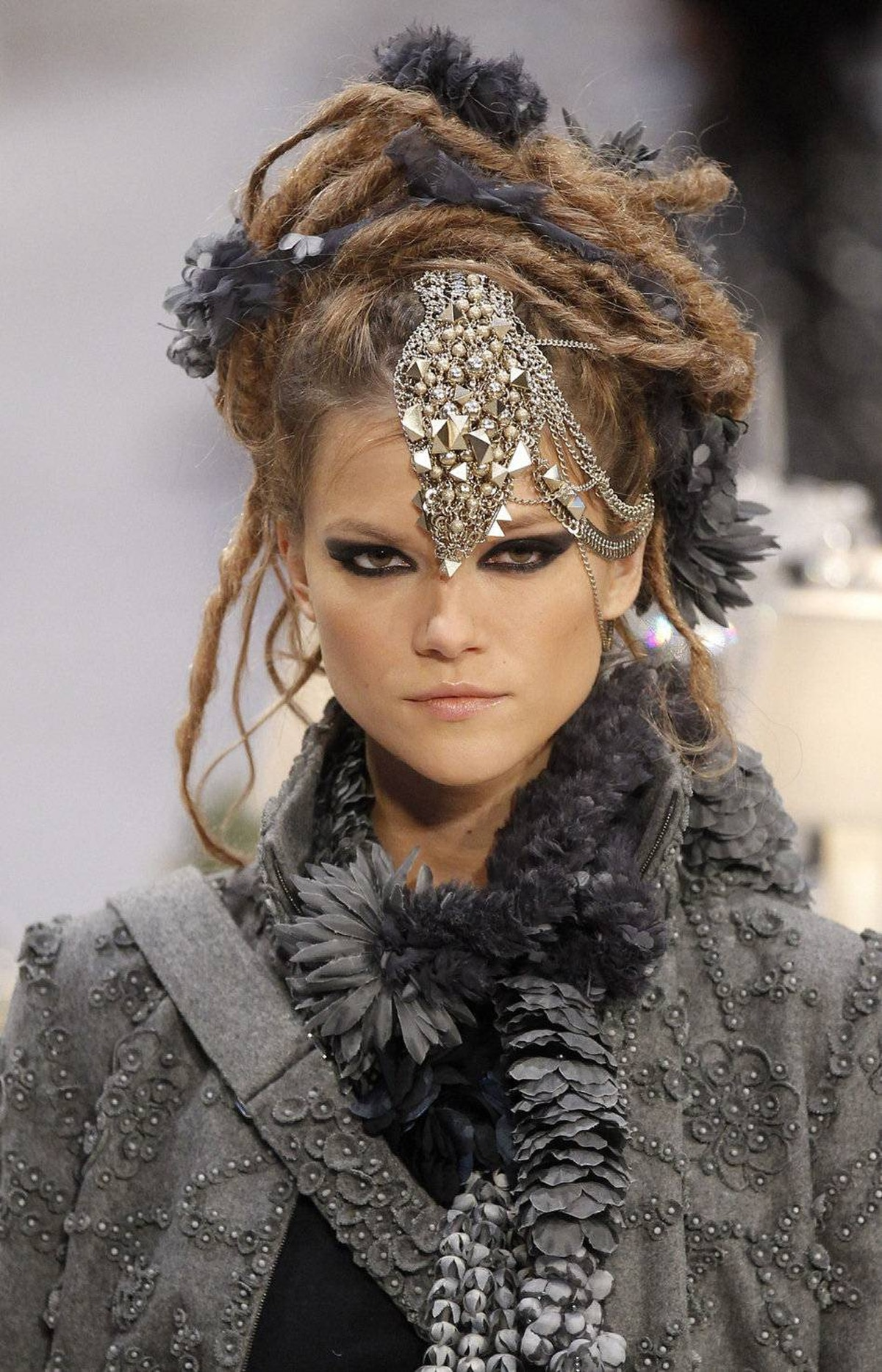 Luxury is being able to combine faux dreadlock hair with an intricately beaded, appliquéd jacket.