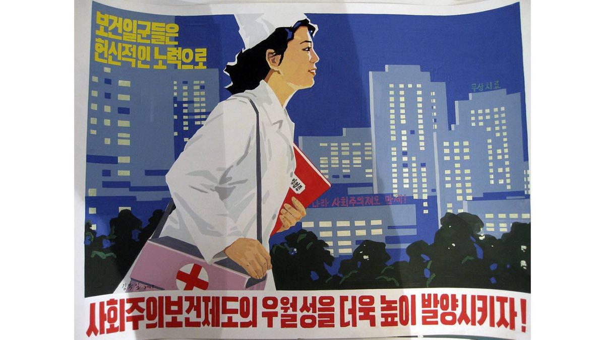 """This North Korean propaganda poster is captioned, """"Let's give a bigger part to the advantages of the socialist treatment system through greater effort."""""""