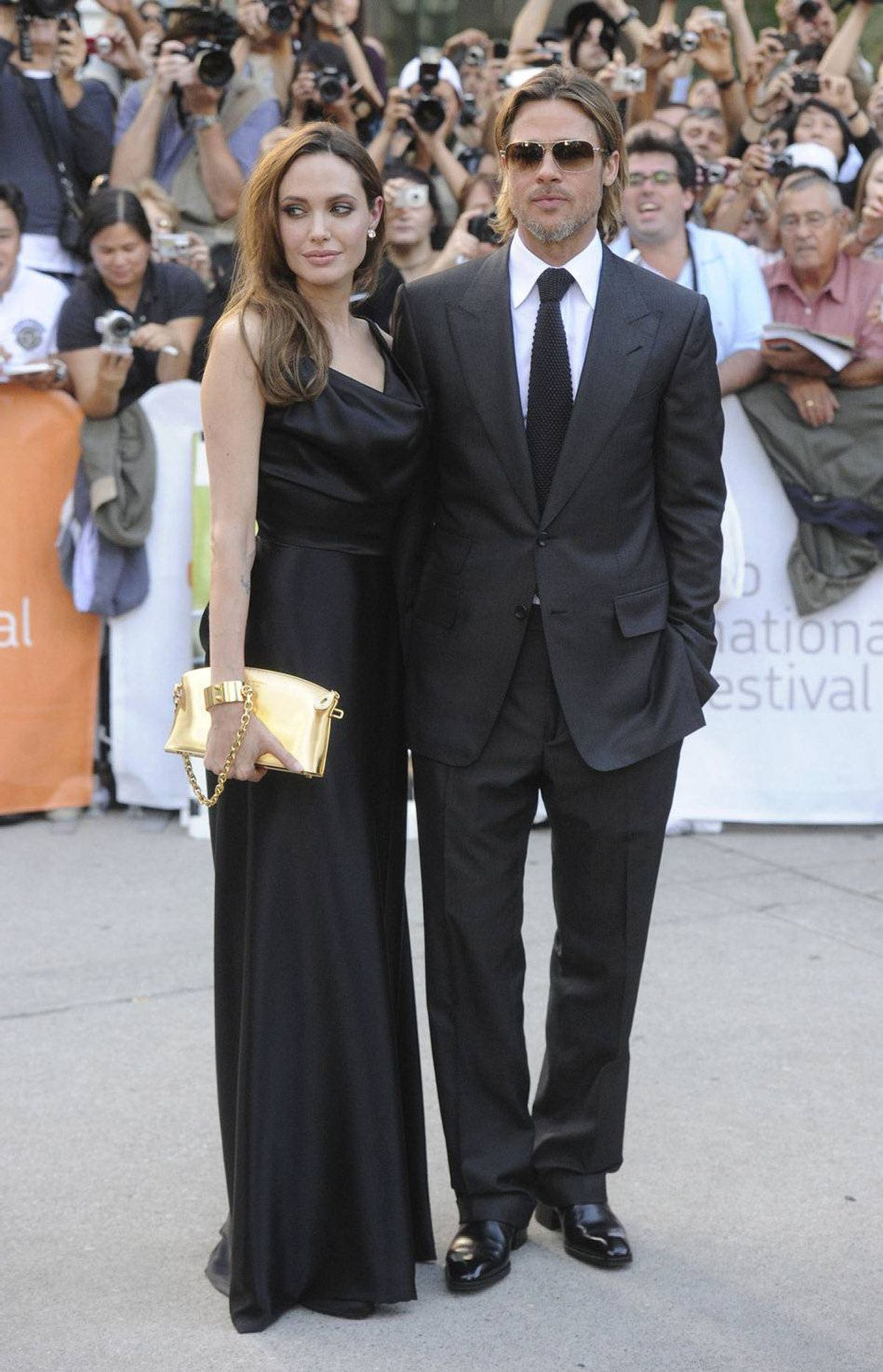 """TORONTO, ON - SEPTEMBER 09: Actress Angelina Jolie (L) and actor/producer Brad Pitt arrive at """"Moneyball"""" Premiere at Roy Thomson Hall during the 2011 Toronto International Film Festival on September 9, 2011 in Toronto, Canada."""