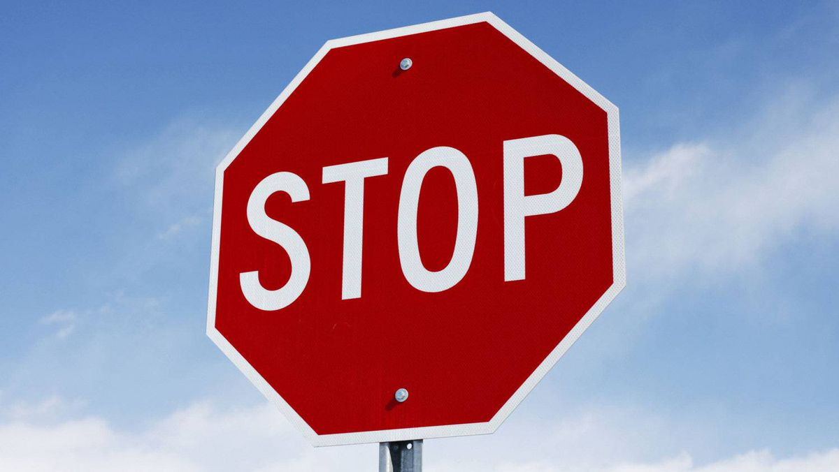 """While many of those signs differ from North American versions – for example, a triangle with a red border is used for warnings – the stop sign is the North American red octagon, complete with the word """"stop"""" in English."""