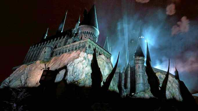 Smoke filters through Hogwarts Castle at The Wizarding World of Harry Potter at the Universal Studio Resort in Orlando, Fla.