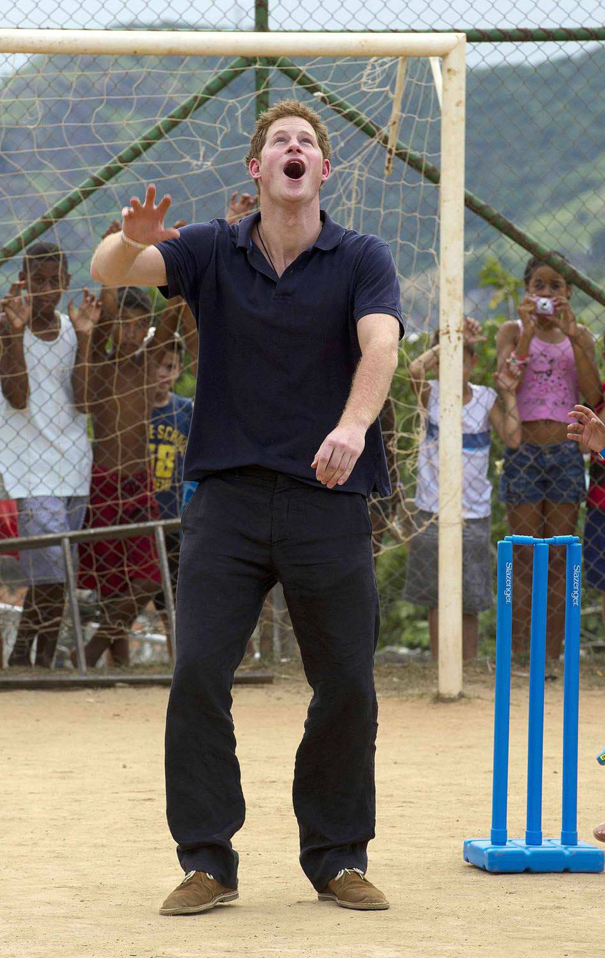 CRICKET PLAYER Britain's Prince Harry plays cricket during a visit to the occupied community of Complexo do Alemao in Rio De Janeiro, March 10, 2012.