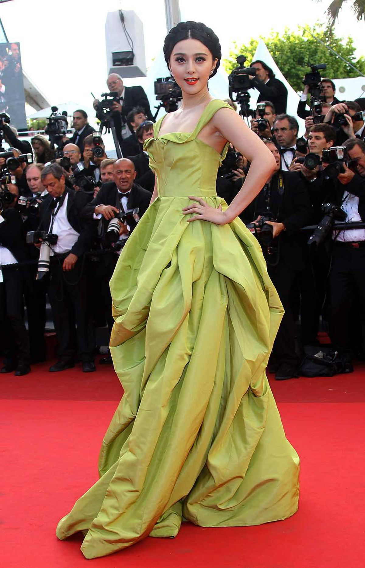 """Chinese actress Fan Bingbing poses on the red carpet before the screening of """"The Tree of Life"""" at the Cannes Film Festival on Monday."""