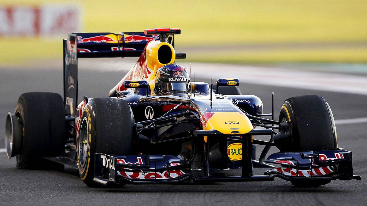 Red Bull Formula One World Champion Sebastian Vettel of Germany drives with a punctured tire during the Abu Dhabi F1 Grand Prix at Yas Marina circuit in Abu Dhabi November 13, 2011. Vettel suffered his first retirement of the season on Sunday after his Red Bull spun off at the second corner of the Abu Dhabi Grand Prix.