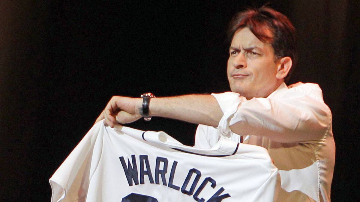 Charlie Sheen shows off his Detroit Tigers jersey during his performance at the Fox Theatre in Detroit.