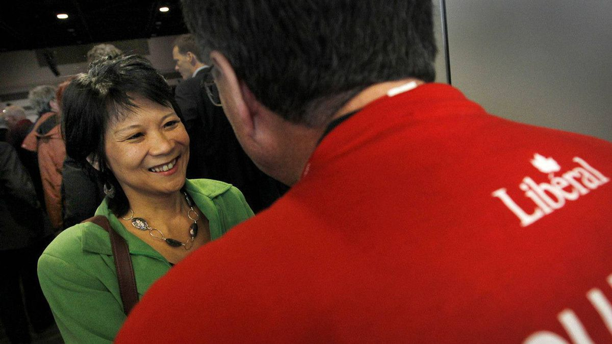 NDP member Olivia Chow, speaks to a Liberal volunteer on the final day of the Liberal Biennial Convention in Ottawa January 15, 2012.