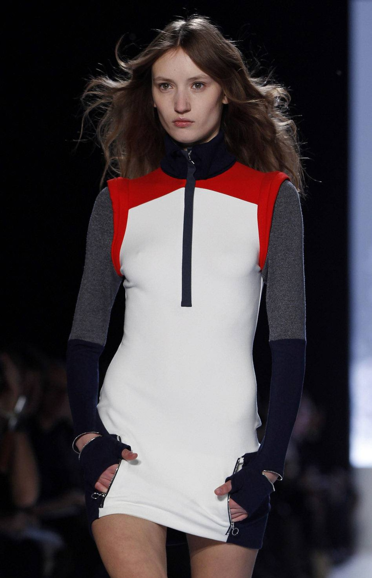A grouping of body-skimming racer dresses, like this one, show designer Felipe Oliveira Baptista's forward vision for the brand, best known for its preppy tennis shirts. Note the placement of a cuff circling the shoulder – a flourish that feels subtly space age.