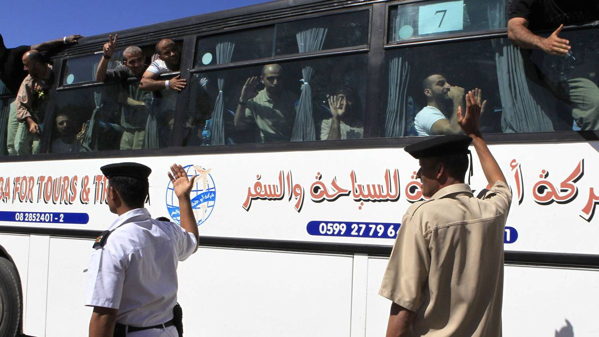 Released Palestinian prisoners wave from a bus as they make their way through the Rafah border crossing between Egypt and Gaza, October 18, 2011. Israeli soldier Gilad Shalit and hundreds of Palestinians crossed Israel's borders in opposite directions on Tuesday as a thousand-for-one prisoner exchange brought joy to families but did little to ease decades of conflict.