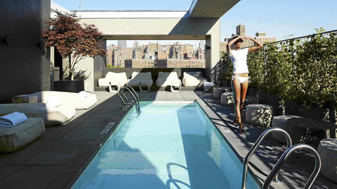 The rooftop terrace with its cabanas and pool (and thermal bath in winter) offers a respite from the busy city.