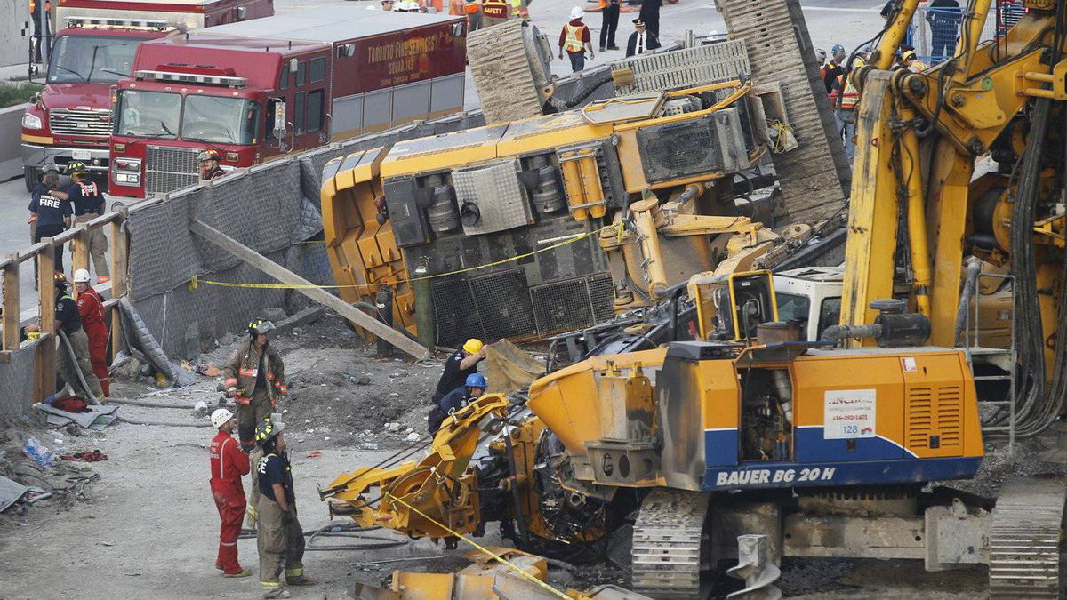Images from the scene at York University in Toronto where a tracked excavation crane apparently fell over onto another piece of machinery at approximately 2:40pm on Oct. 11, 2011, killing one man and injuring several people on the ground.