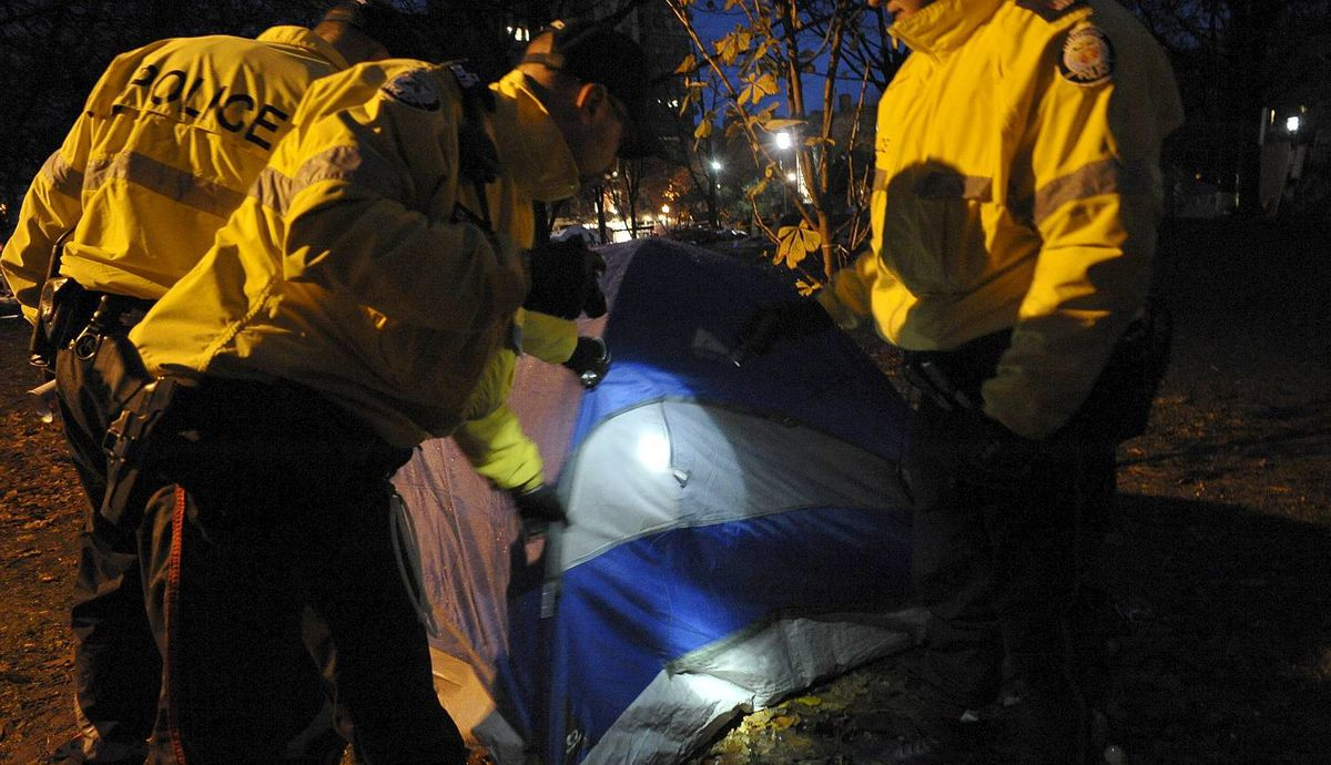 Police enter the Occupy Toronto camp at St. James Park in Toronto Wednesday, November 23, 2011. (J.P. Moczulski for The Globe and Mail)