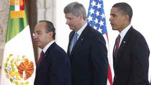 Prime Minister Stephen Harper, centre, Mexican President Felipe Calderon, left, and U.S. President Barack Obama make their way to a joint news conference at the conclusion of the North American Leaders Summit in Guadalajara, Mexico, on Aug. 10, 2009.