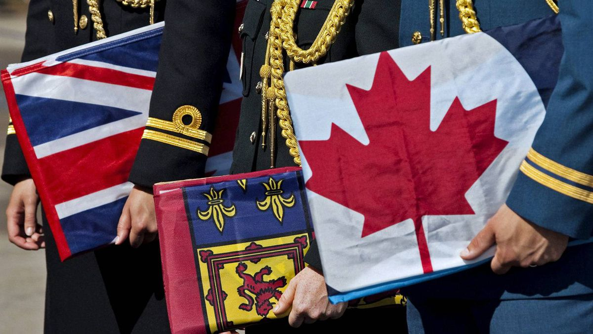 Navy, army and air-force officers hold flags of the three forces at a Halifax ceremony announcing the government's decision to restore their traditional names on Aug. 16, 2011.