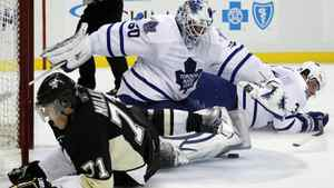 Pittsburgh Penguins' Evgeni Malkin (71), of Russia, slides into Toronto Maple Leafs goalie Jonas Gustavsson (50) of Sweden after being brought down by defenseman Dion Phaneuf (3) on a breakaway in the second period of an NHL hockey game in Pittsburgh on Wednesday, Oct. 13, 2010. Malkin was awarded a penalty shot, but did not score. The Maple Leafs won 4-3.