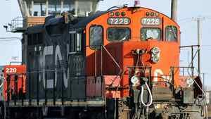 A CN locomotive makes it's way through the CN Taschereau yard in Montreal, Saturday, Nov., 28, 2009.