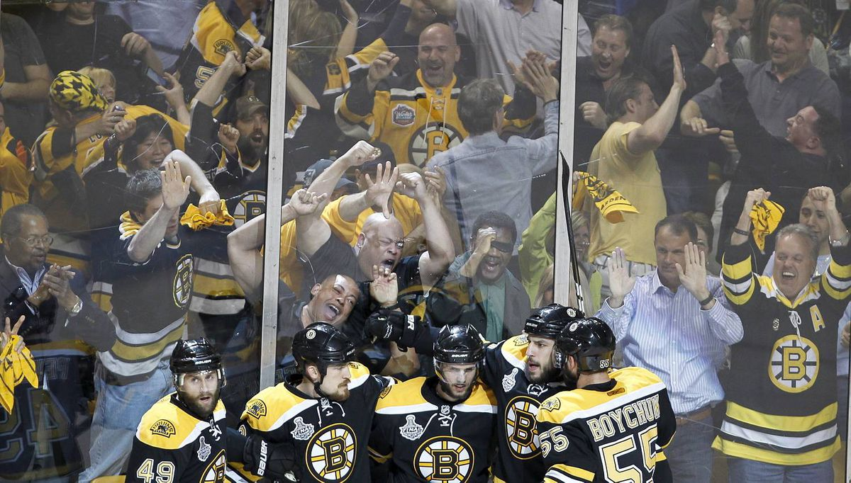 Boston Bruins players and fans celebrate the third goal during the first period of Game 6 in Boston on June 13, 2011. (Photo by Peter Power/The Globe and Mail)